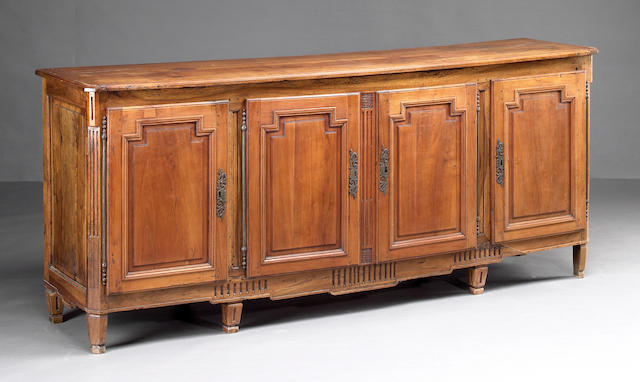 A Louis XVI fruitwood and walnut enfilade