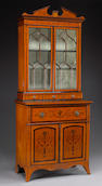A George III style crossbanded and marquetry satinwood secretary bookcase