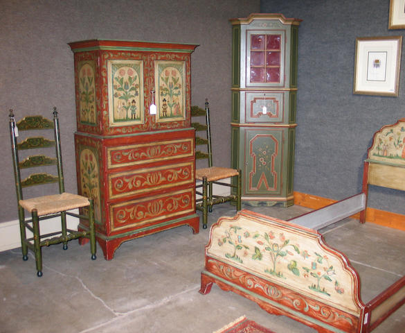 An assembled bedroom suite polychrome decorated in a Scandinavian style, comprising a linen press, nightstand, mirror-back dressing table, a pair of twins beds, side chair and a mirror