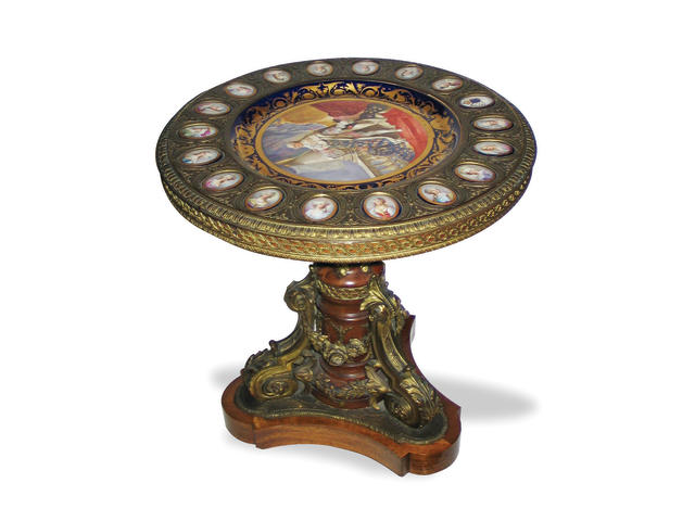 A Louis XVI style gilt bronze mounted and porcelain