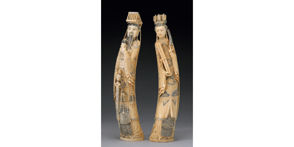 A pair of tinted ivory emperor and empress figures