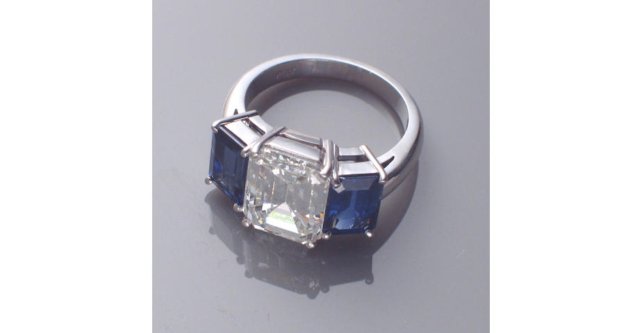 A diamond, sapphire and platinum ring