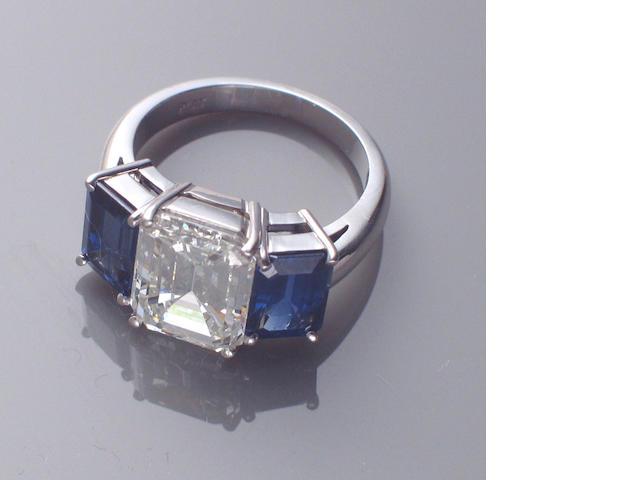 A diamond, sapphire and platinum ring
