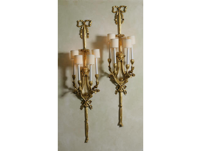 A set of four Neoclassical style gilt-metal sconces