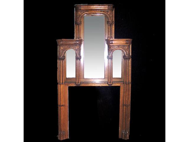 A Continental carved oak fire surround in architectural form