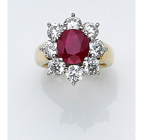 A ruby, diamond, platinum and eighteen karat gold ring