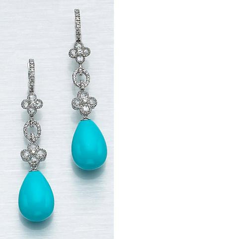 A pair of turquoise, diamond and eighteen karat white gold earrings