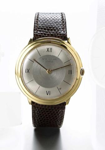 Patek Philippe. An 18k gold wristwatch with two-tone silvered dialRef.2501, Case No.689733, Movement No.745377, circa 1955