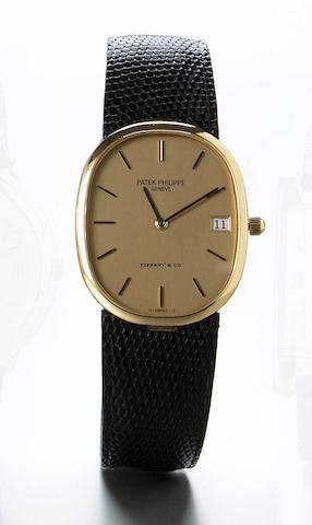 Patek Philippe. A fine 18k gold quartz wristwatch with date, retailed by Tiffany & Co.'Ellipse' Ref.3788. Case No.28730667. Movement No.1583860, made circa 1985