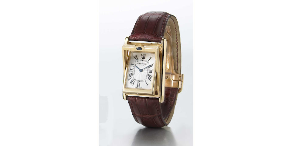 Cartier. A fine 18k rose gold reversible wristwatch with visible movement and 18k gold deployant clasp Basculante, Ref.2499C, No.0035, made circa 2000