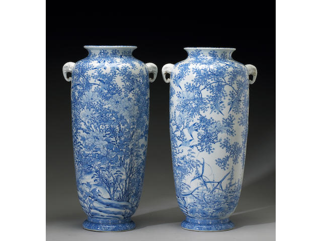 A pair of Seto blue and white porcelain high shouldered ovoid vases decorated with birds and seasona