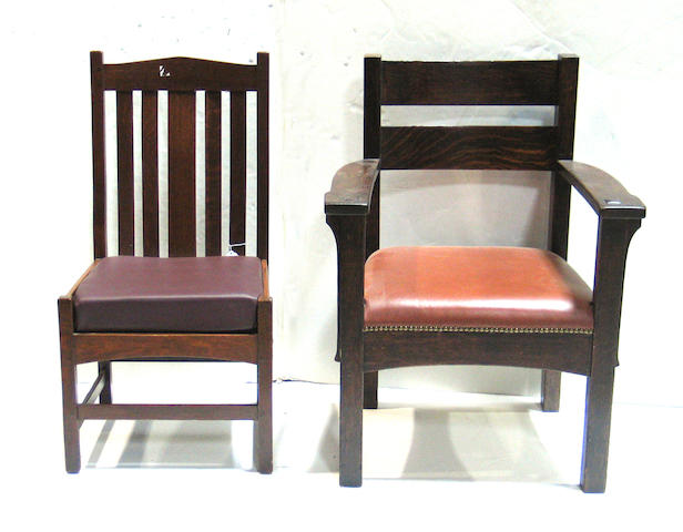 A pair of of Arts and Crafts oak arm chairs together with a similar side chair