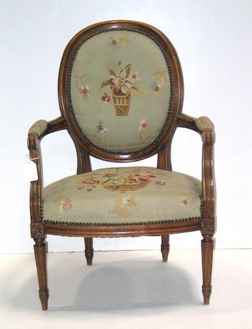 A pair of Louis XVI style walnut fauteuils