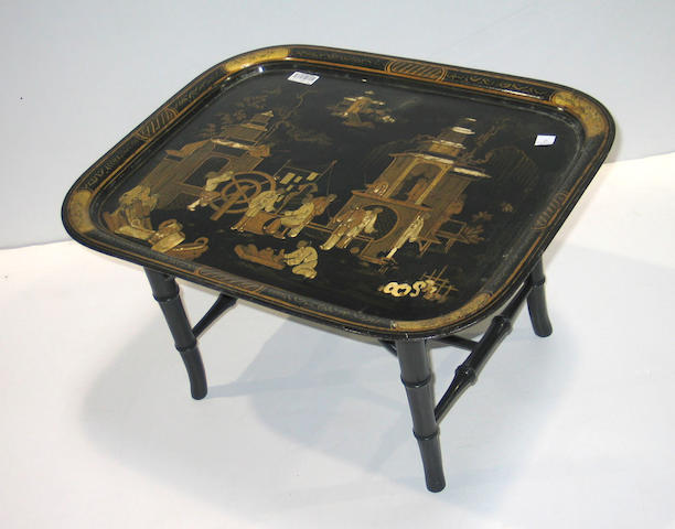 A Victorian chinoiserie decorated tray on ebonized stand