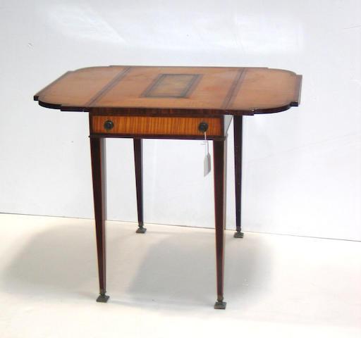 A George III style satinwood inlaid mahogany pembroke table