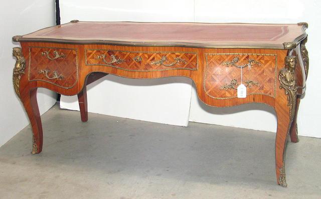 A Louis XV style gilt bronze mounted tulipwood and kingwood bureau plat