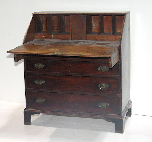 A George III oak slant lid desk