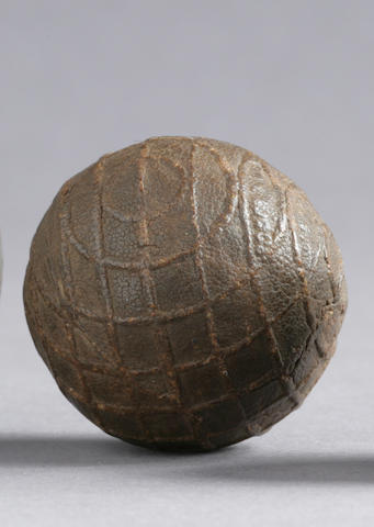 A small sized patented ball for children inscribed upon its surface in relief a series of curved lines,