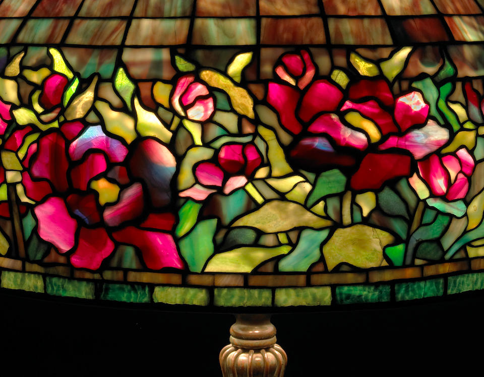 A Tiffany Studios bronze and Favrile glass 'Peony' border floor lamp