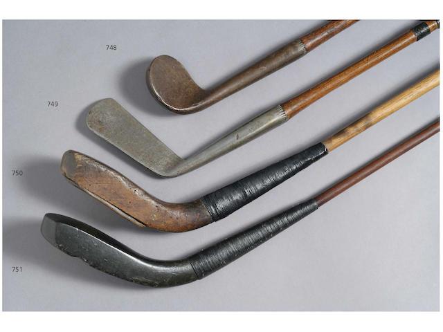 A Thomas Johnston Edinburgh prototype Vulcanite headed Long Spoon, circa 1876,