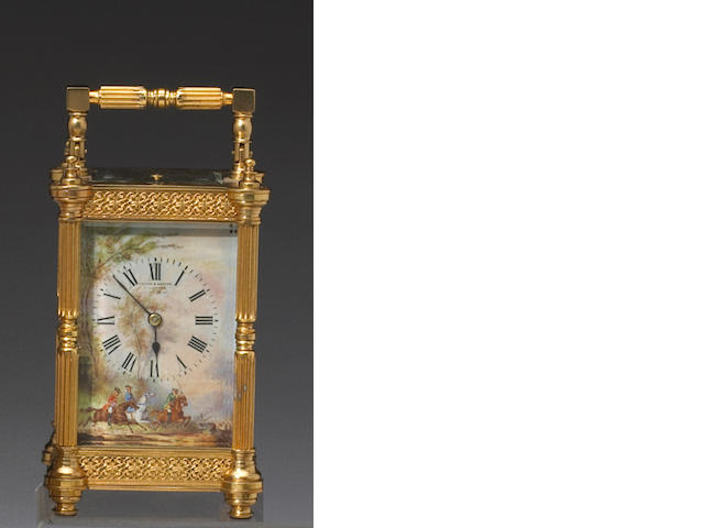 A French gilt bronze repeating carriage clock