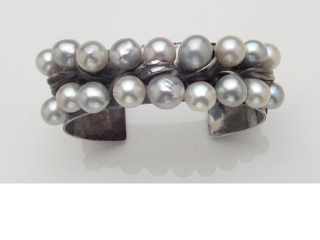 A baroque cultured pearl and sterling silver cuff bangle