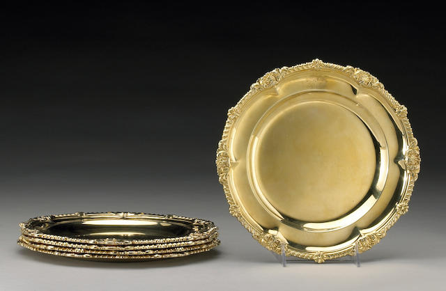 A matching set of five Regency and Victorian silver gilt dinner plates Paul Storr, London, 1811 (4), with engraved arms Garrard & Co., London, 1846 (1), with another engraved armorial