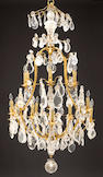 A Louis XV style gilt bronze, brass, rock crystal and glass eighteen light chandelier