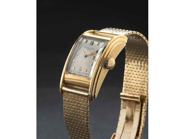 Patek Philippe & Co. A fine and rare 18k gold asymmetrical 'drivers watch' on 14k gold bracelet Case No.615584, Movement No.850396, circa 1937