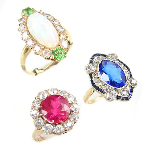 A collection of opal, diamond, stone and gold rings