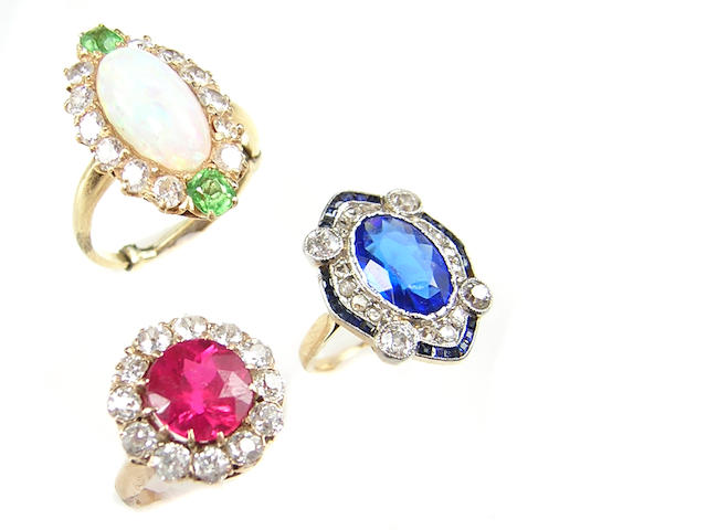 A collection of opal diamond, stone and gold rings