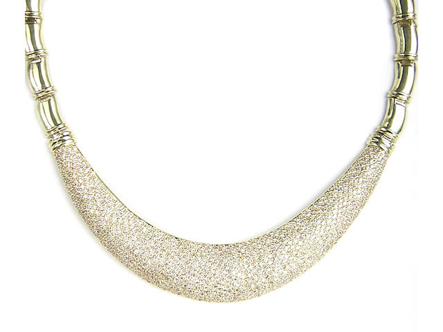A diamond and 18 karat yellow gold necklace