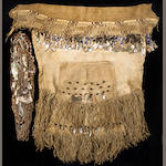 A Hupa ceremonial dance skirt, apron and necklaces, with accompanying photo