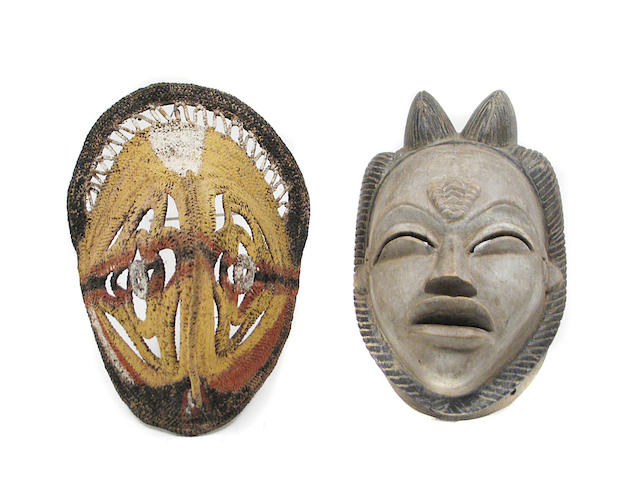 A collection of Tribal decorative masks and carvings in various media