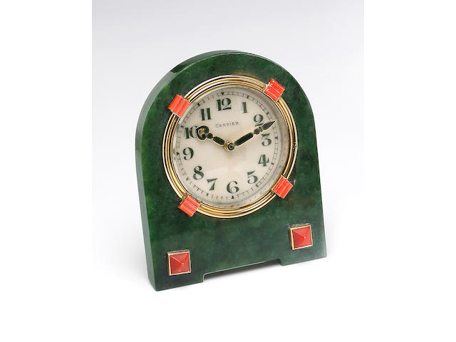 Cartier. An fine and rare nephrite, coral, gold and brass eight day table strut clockNo.2380, 4140, 1920s
