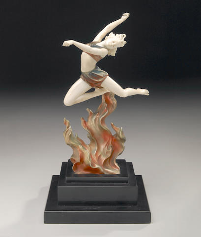 A cold-painted bronze and ivory figure: Flame Leaper