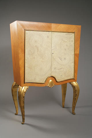 A good Maison Jansen parcel-gilt fruitwood and parchment cabinet