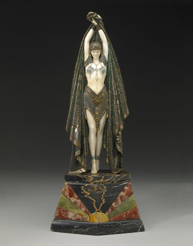 A cold painted bronze and ivory figure: Antinea