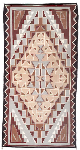 A large Navajo rug, 15ft 7in x 8ft 1in