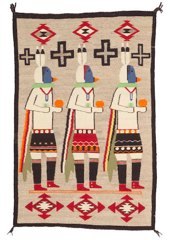 A Navajo Yeibechai rug, 4ft 10in x 3ft 2in