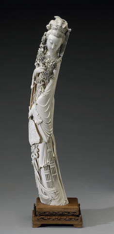 A large carved ivory figure of a court beauty