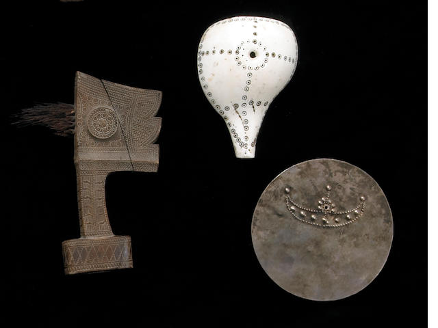 Three Asian items: breastplate, sword hilt, shell