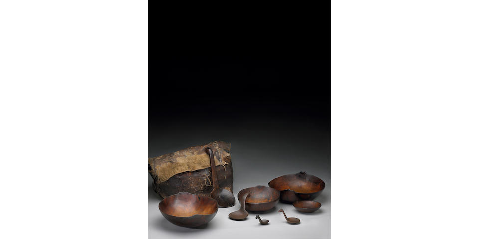 A set of Omaha bowls, ladles and carrying trunk