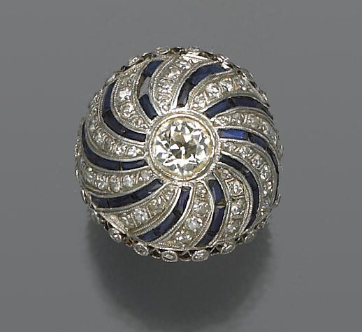 An art deco diamond, synthetic sapphire and platinum ring,