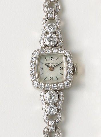 Patek Philippe & Co. A Lady's platinum and diamond set cocktail watch Movement No.865842, circa 1945