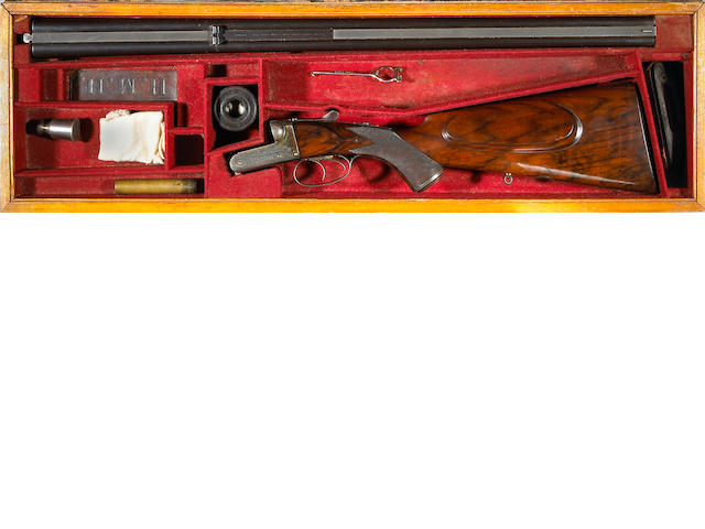 A .450-400 – 2 7/8 black powder express J. Purdey & Sons C-quality boxlock double rifle (For 1893)