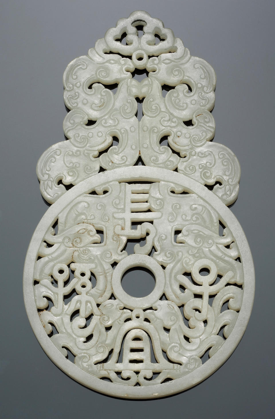 A fine and rare white jade pendant and imperial storage box Qianlong Mark and Period