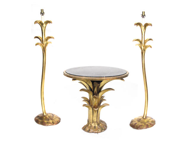 An Art Deco style occasional table and two matching floor lamps
