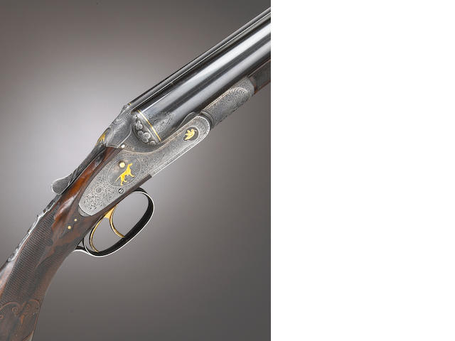 A rare 12 gauge Lefever Optimus grade double barrel shotgun