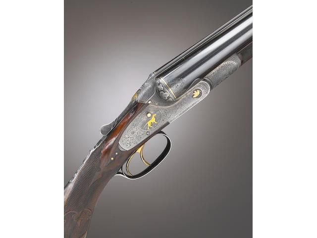 A rare 12 gauge Lefever Optimus grade double barrel shotgun